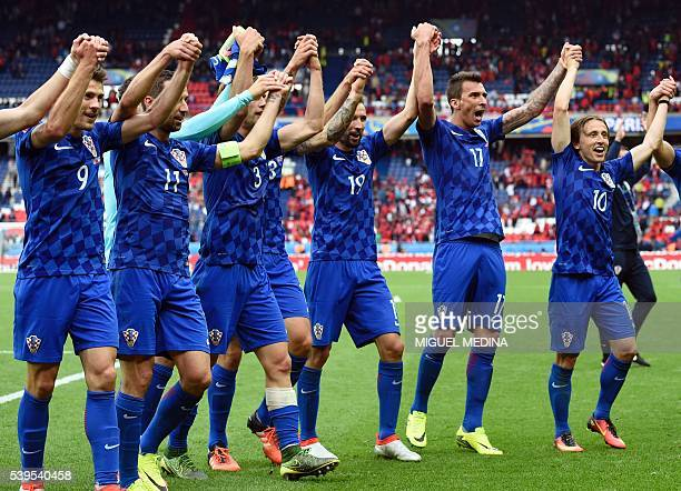 Croatia's midfielder Luka Modric and teammates celebrate a 10 victory following the Euro 2016 group D football match between Turkey and Croatia at...