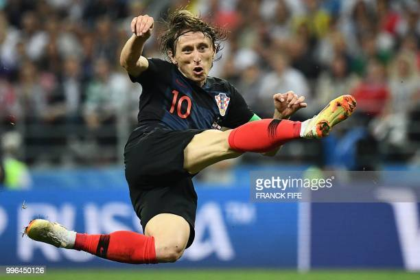 TOPSHOT Croatia's midfielder Luka Modric attempts a shot during the Russia 2018 World Cup semifinal football match between Croatia and England at the...
