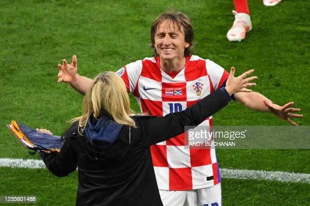 Croatia's midfielder Luka Modric celebrate their win in the UEFA EURO 2020 Group D football match between Croatia and Scotland at Hampden Park in...