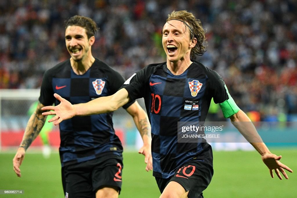 TOPSHOT - Croatia's midfielder Luka Modric (R) celebrates after scoring their second goal during the Russia 2018 World Cup Group D football match between Argentina and Croatia at the Nizhny Novgorod Stadium in Nizhny Novgorod on June 21, 2018. (Photo by Johannes EISELE / AFP) / RESTRICTED