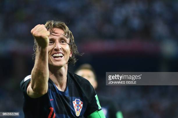 Croatia's midfielder Luka Modric celebrates after scoring their second goal during the Russia 2018 World Cup Group D football match between Argentina...