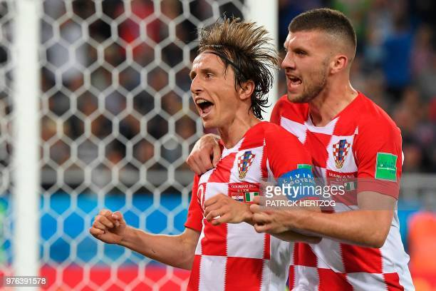 TOPSHOT Croatia's midfielder Luka Modric celebrates scoring a penalty with his teammate forward Ante Rebic during the Russia 2018 World Cup Group D...
