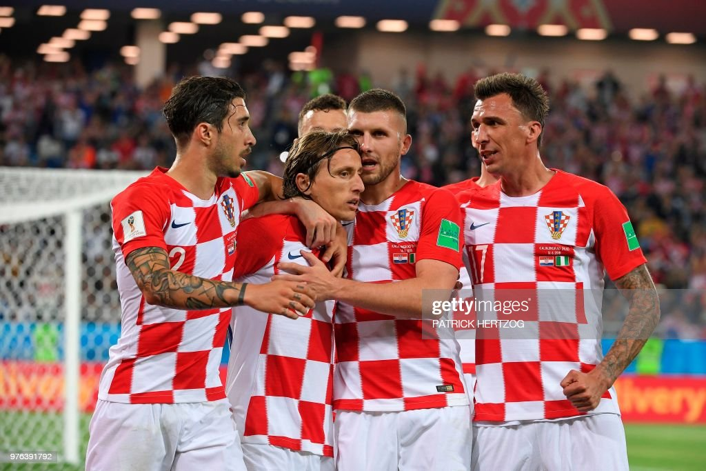 Croatia's midfielder Luka Modric (2nd L) celebrates scoring a penalty with his teammates during the Russia 2018 World Cup Group D football match between Croatia and Nigeria at the Kaliningrad Stadium in Kaliningrad on June 16, 2018. (Photo by Patrick HERTZOG / AFP) / RESTRICTED