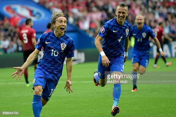 Croatia's midfielder Luka Modric celebrates the team's first goal during the Euro 2016 group D football match between Turkey and Croatia at Parc des...
