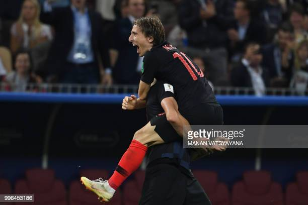 Croatia's midfielder Luka Modric celebrates their win after the Russia 2018 World Cup semifinal football match between Croatia and England at the...