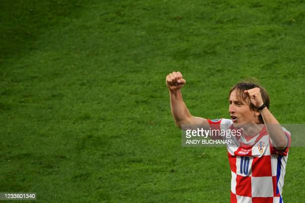 Croatia's midfielder Luka Modric celebrates with the fans after their win in the UEFA EURO 2020 Group D football match between Croatia and Scotland...