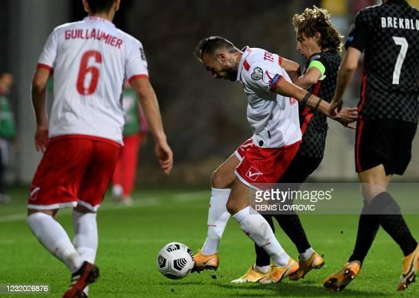 Croatia's midfielder Luka Modric challenges Malta's forward Teddy Teuma during the FIFA World Cup Qatar 2022 qualification Group H football match...
