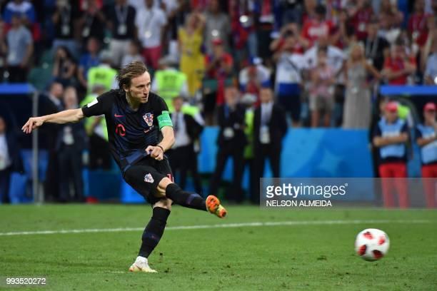 TOPSHOT Croatia's midfielder Luka Modric converts a penalty during the Russia 2018 World Cup quarterfinal football match between Russia and Croatia...