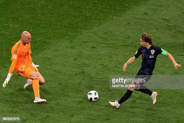 Croatia's midfielder Luka Modric faces Argentina's goalkeeper Willy Caballero during the Russia 2018 World Cup Group D football match between...