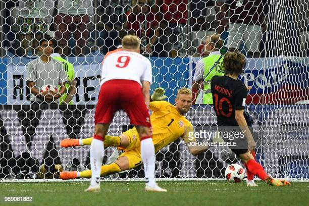 Croatia's midfielder Luka Modric fails to score a penalty against Denmark's goalkeeper Kasper Schmeichel in the extra time of the Russia 2018 World...