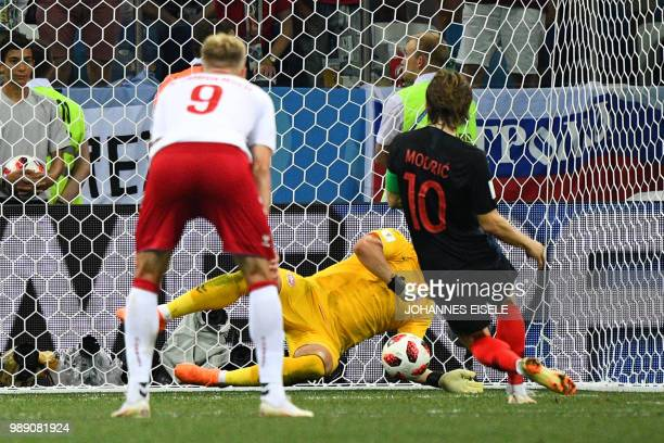 Croatia's midfielder Luka Modric fails to score a penalty against Denmark's goalkeeper Kasper Schmeichel in the extra time of the Russia 2018 World...