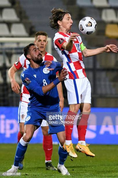 Croatia's midfielder Luka Modric fights for the ball with Cyprus' midfielder Charis Kyriakou during the FIFA World Cup Qatar 2022 qualification Group...