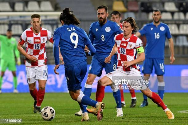 Croatia's midfielder Luka Modric fights for the ball with the Cyprus' forward Marios Ilia during the FIFA World Cup Qatar 2022 qualification Group H...