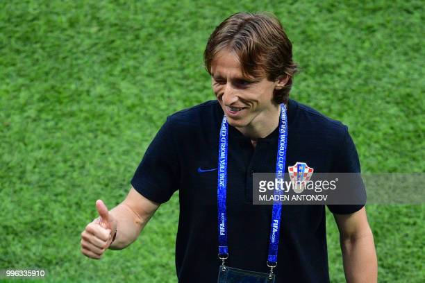 Croatia's midfielder Luka Modric gestures as he walks on the pitch prior the Russia 2018 World Cup semifinal football match between Croatia and...