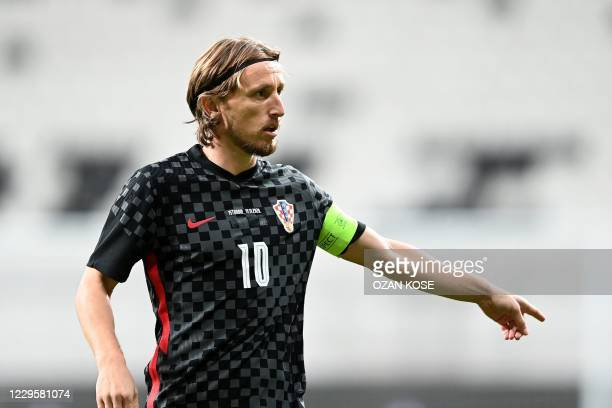 Croatia's midfielder Luka Modric gestures during the friendly football match between Turkey and Croatia at the Vodafone Park in Istanbul on November...