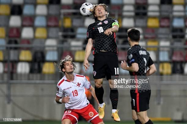 Croatia's midfielder Luka Modric heads the ball past Malta's midfielder Bjorn Kristensen during the FIFA World Cup Qatar 2022 qualification Group H...