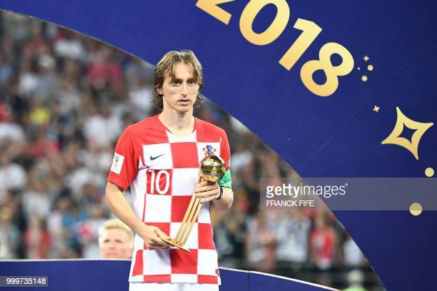 Croatia's midfielder Luka Modric holds the adidas Golden Ball prize during the trophy ceremony at the end of the Russia 2018 World Cup final football...