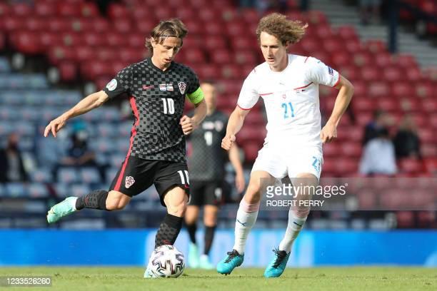 Croatia's midfielder Luka Modric is marked by Czech Republic's midfielder Alex Kral during the UEFA EURO 2020 Group D football match between Croatia...