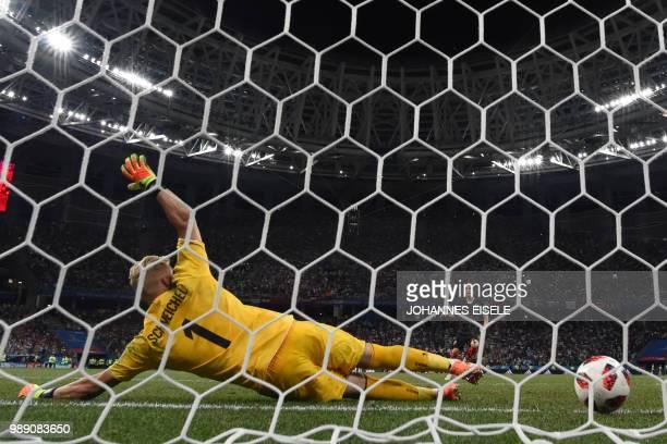 TOPSHOT Croatia's midfielder Luka Modric kicks and scores a penalty against Denmark's goalkeeper Kasper Schmeichel during the penalty shootout of the...