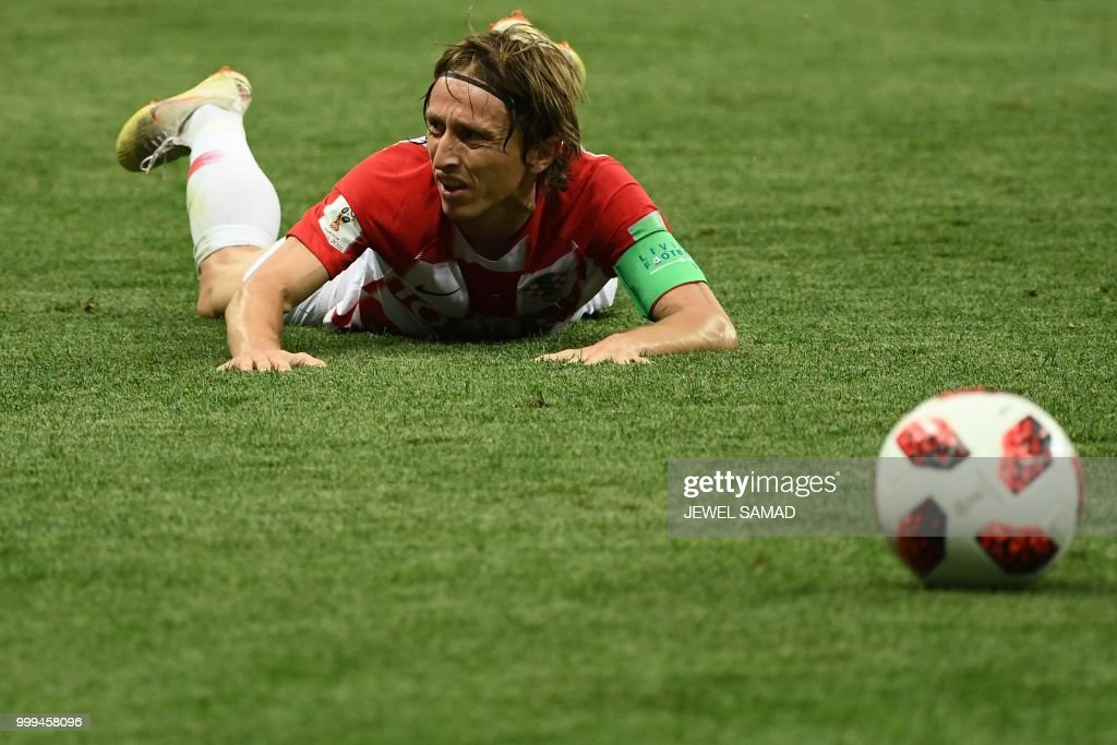 TOPSHOT - Croatia's midfielder Luka Modric reacts after a challenge during the Russia 2018 World Cup final football match between France and Croatia at the Luzhniki Stadium in Moscow on July 15, 2018. (Photo by Jewel SAMAD / AFP) / RESTRICTED