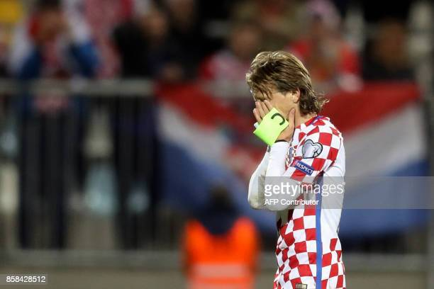 Croatia's midfielder Luka Modric reacts after the FIFA World Cup 2018 qualification football match between Croatia and Finland in Rijeka on October...