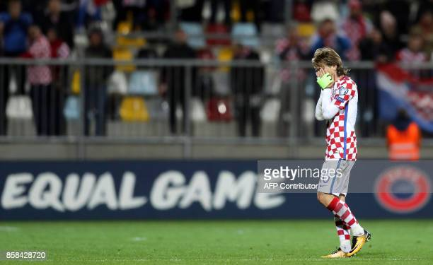 Croatia's midfielder Luka Modric reacts at the end of the FIFA World Cup 2018 qualification football match between Croatia and Finland in Rijeka on...