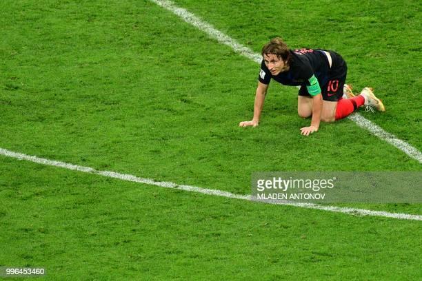 Croatia's midfielder Luka Modric reacts during the Russia 2018 World Cup semifinal football match between Croatia and England at the Luzhniki Stadium...