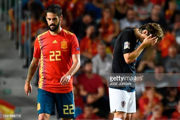 Croatia's midfielder Luka Modric reacts next to Spain's midfielder Isco after a new goal by Spain during the UEFA Nations League A group 4 football...