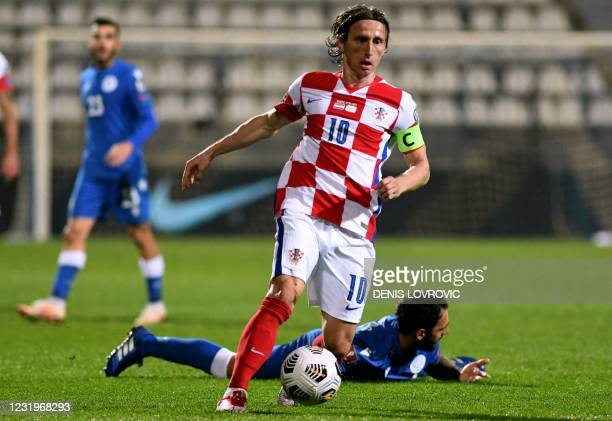 Croatia's midfielder Luka Modric runs with the ball during the FIFA World Cup Qatar 2022 qualification Group H football match between Croatia and...