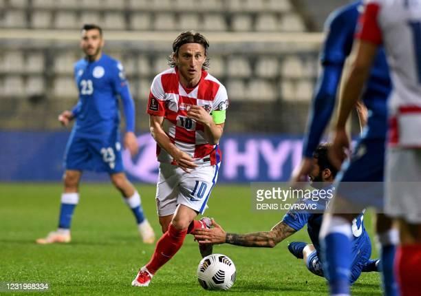 Croatia's midfielder Luka Modric runs with the ball during the FIFA World Cup Qatar 2022 qualification Group H football match between Croatia and...