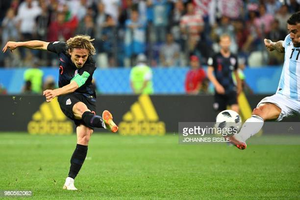 TOPSHOT Croatia's midfielder Luka Modric scores their second goal during the Russia 2018 World Cup Group D football match between Argentina and...