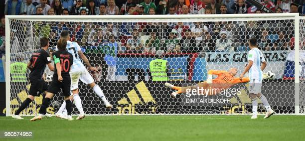 Croatia's midfielder Luka Modric scores their second goal during the Russia 2018 World Cup Group D football match between Argentina and Croatia at...