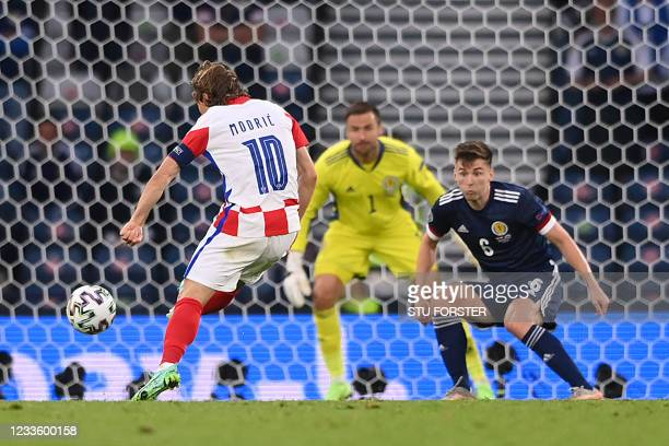Croatia's midfielder Luka Modric shoots to score the second goal during the UEFA EURO 2020 Group D football match between Croatia and Scotland at...
