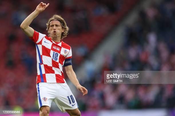 Croatia's midfielder Luka Modric speaks to teammates during the UEFA EURO 2020 Group D football match between Croatia and Scotland at Hampden Park in...