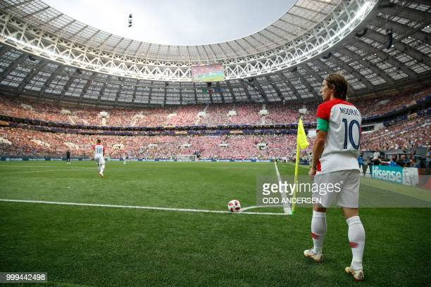 Croatia's midfielder Luka Modric takes a corner during the Russia 2018 World Cup final football match between France and Croatia at the Luzhniki...