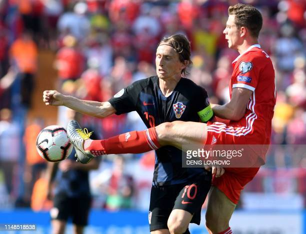 Croatia's midfielder Luka Modric vies for the ball against Wales midfielder James Lawrence during the Euro 2020 qualification football match between...