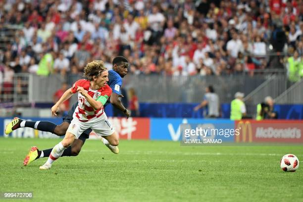 Croatia's midfielder Luka Modric vies for the ball with France's midfielder Paul Pogba during their Russia 2018 World Cup final football match...