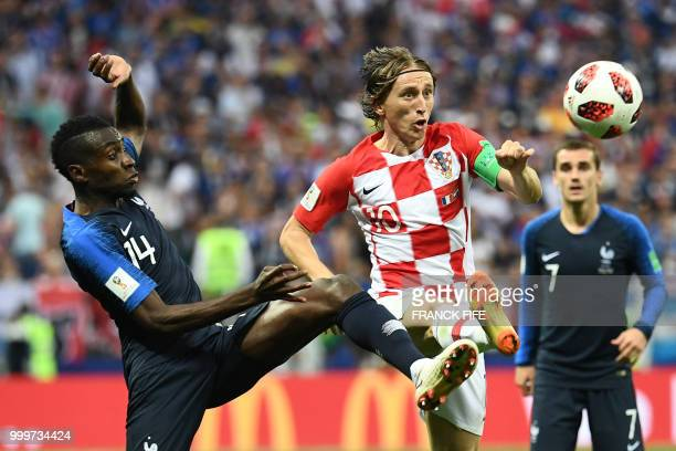 TOPSHOT Croatia's midfielder Luka Modric vies with France's midfielder Blaise Matuidi during the Russia 2018 World Cup final football match between...