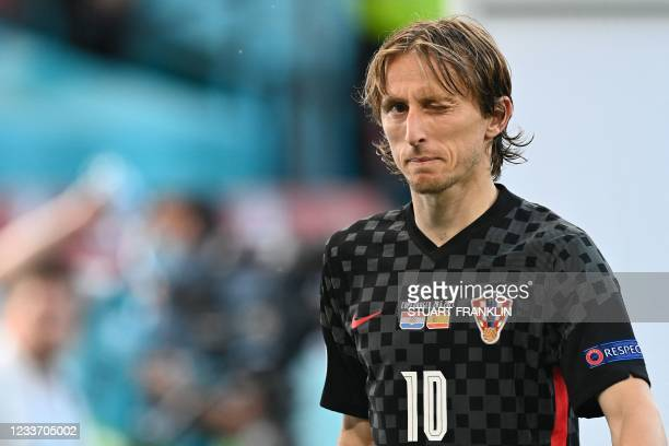 Croatia's midfielder Luka Modric winks at the end of the UEFA EURO 2020 round of 16 football match between Croatia and Spain at the Parken Stadium in...