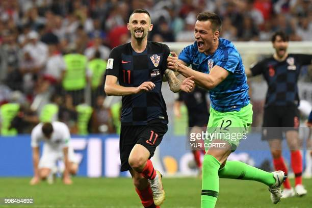 Croatia's midfielder Marcelo Brozovic and Croatia's goalkeeper Lovre Kalinic celebrate at the end of the Russia 2018 World Cup semifinal football...