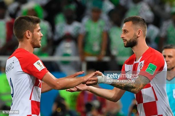 Croatia's midfielder Marcelo Brozovic comes on for Croatia's forward Andrej Kramaric during the Russia 2018 World Cup Group D football match between...