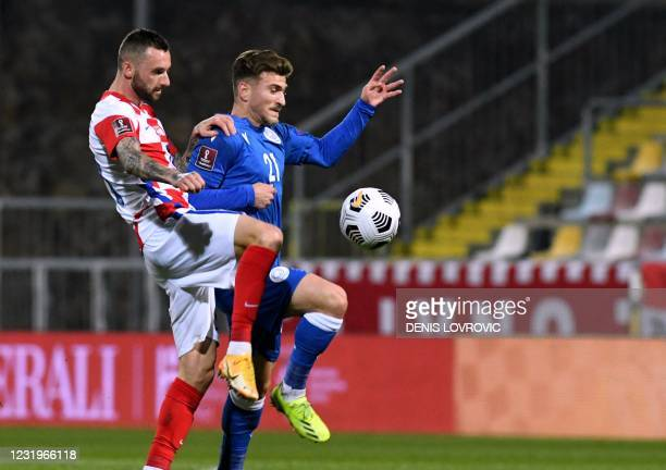Croatia's midfielder Marcelo Brozovic fights for the ball with Cyprus' forward Marinos Tzionis during the FIFA World Cup Qatar 2022 qualification...