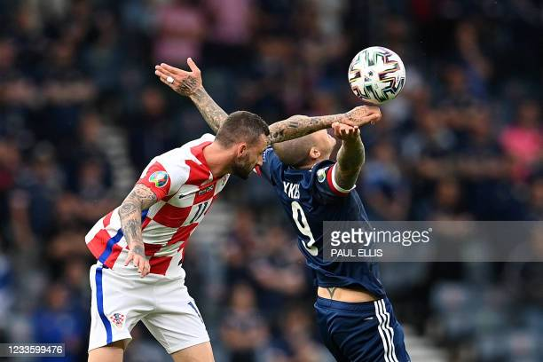 Croatia's midfielder Marcelo Brozovic vies for the ball with Scotland's forward Lyndon Dykes during the UEFA EURO 2020 Group D football match between...