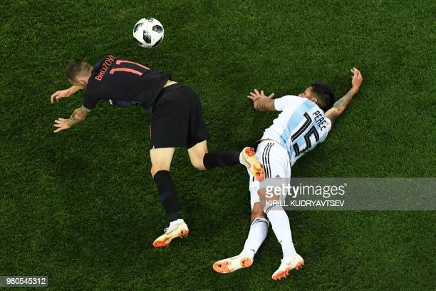 TOPSHOT Croatia's midfielder Marcelo Brozovic vies with Argentina's midfielder Enzo Perez during the Russia 2018 World Cup Group D football match...