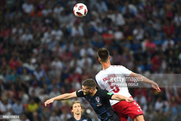TOPSHOT Croatia's midfielder Mateo Kovacic fights for the ball with Denmark's defender Jonas Knudsen during the Russia 2018 World Cup round of 16...