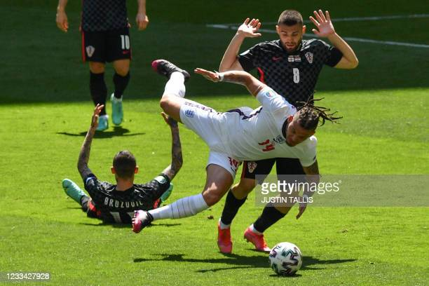Croatia's midfielder Mateo Kovacic fouls England's midfielder Kalvin Phillips during the UEFA EURO 2020 Group D football match between England and...