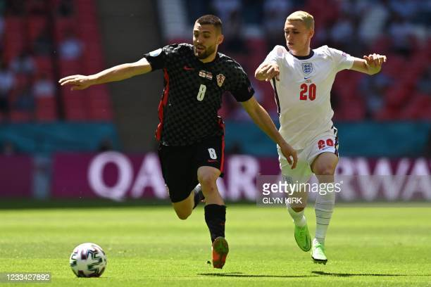 Croatia's midfielder Mateo Kovacic is challenged by England's midfielder Phil Foden during the UEFA EURO 2020 Group D football match between England...