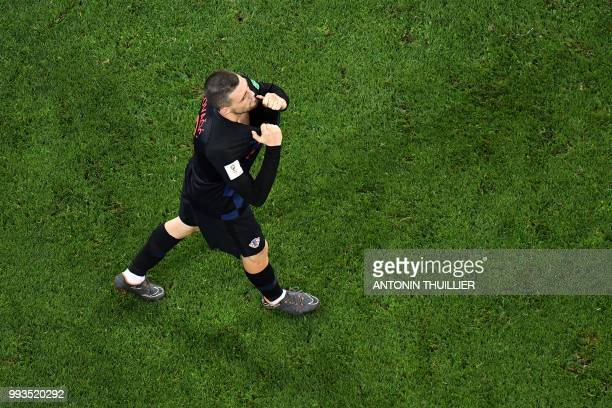 Croatia's midfielder Mateo Kovacic reacts after missing his penalty during the penalty shootouts of the Russia 2018 World Cup quarterfinal football...