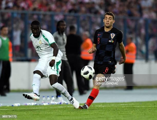 Croatia's midfielder Mateo Kovacic vies with Senegal's midfielder Papa Alioune N'Diaye during a friendly football match between Croatia and Senegal...