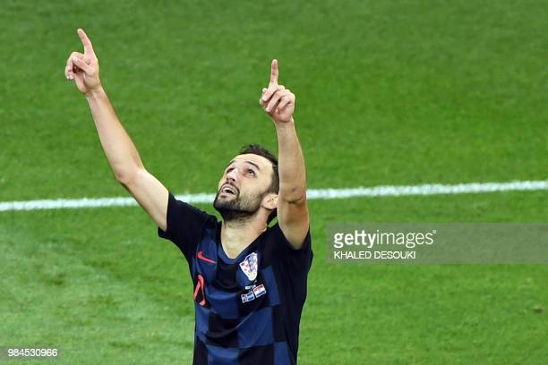 TOPSHOT Croatia's midfielder Milan Badelj celebrates after scoring a goal during the Russia 2018 World Cup Group D football match between Iceland and...